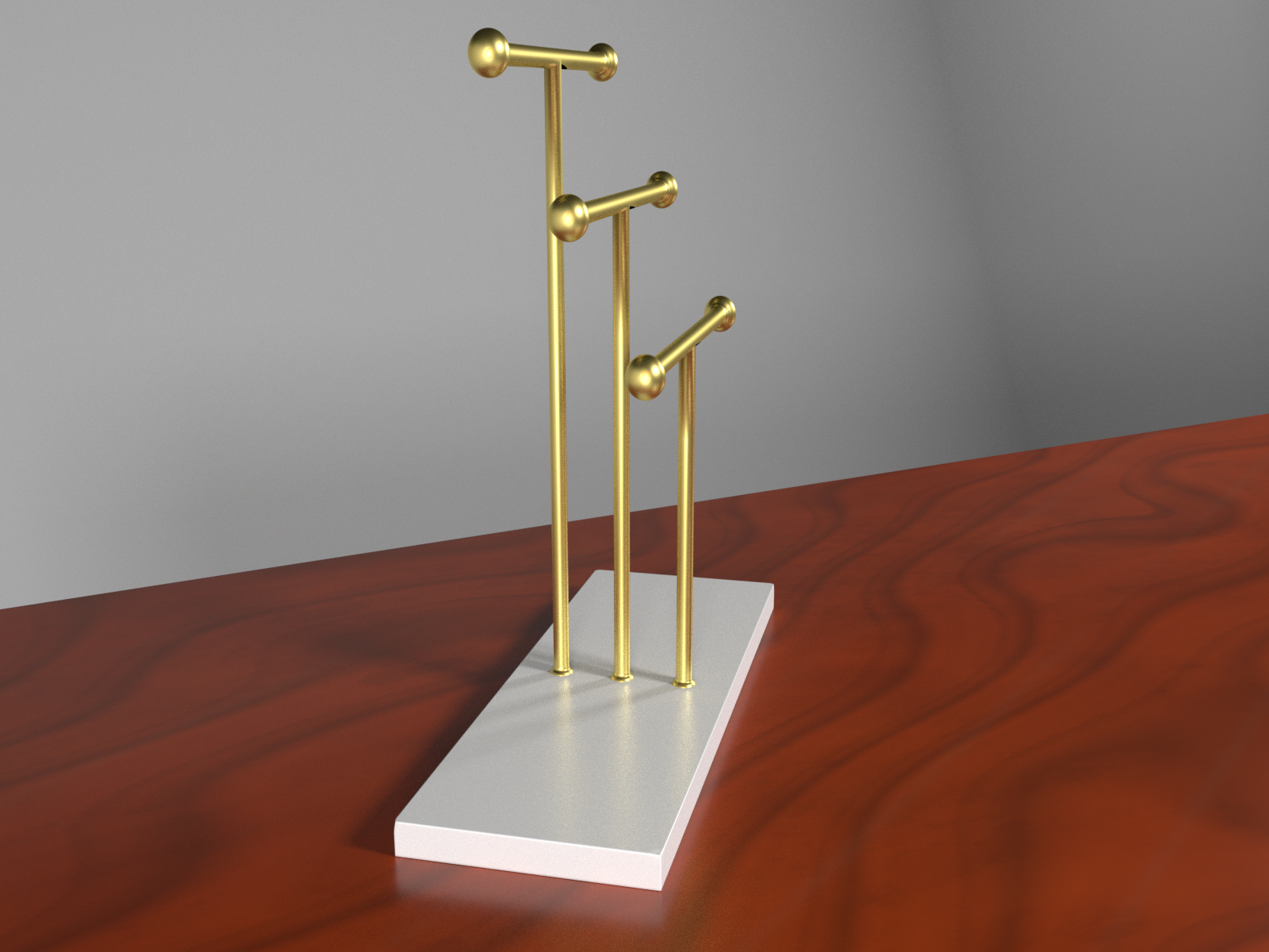 Golden jewelry holder on mahogany desk preview image 2